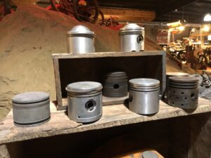 Collection of old Harley pistons at Wheels Through Time