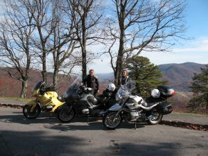 """Mark & Terri – Mark poses by his current favorite ride, a 1995 R1100RS we call """"The Banana!"""""""